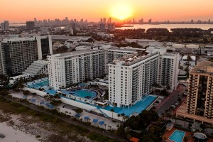 Aerial of Collins Condominium (Gansvort) on Miami Beach taken at sunset and twilight.