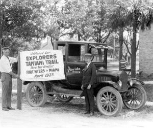 Tamiami Trailblazer holding sign. Photo courtesy of  the State Archives of Florida.